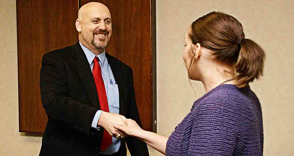 david-heiman-greeting-client-hand-shake